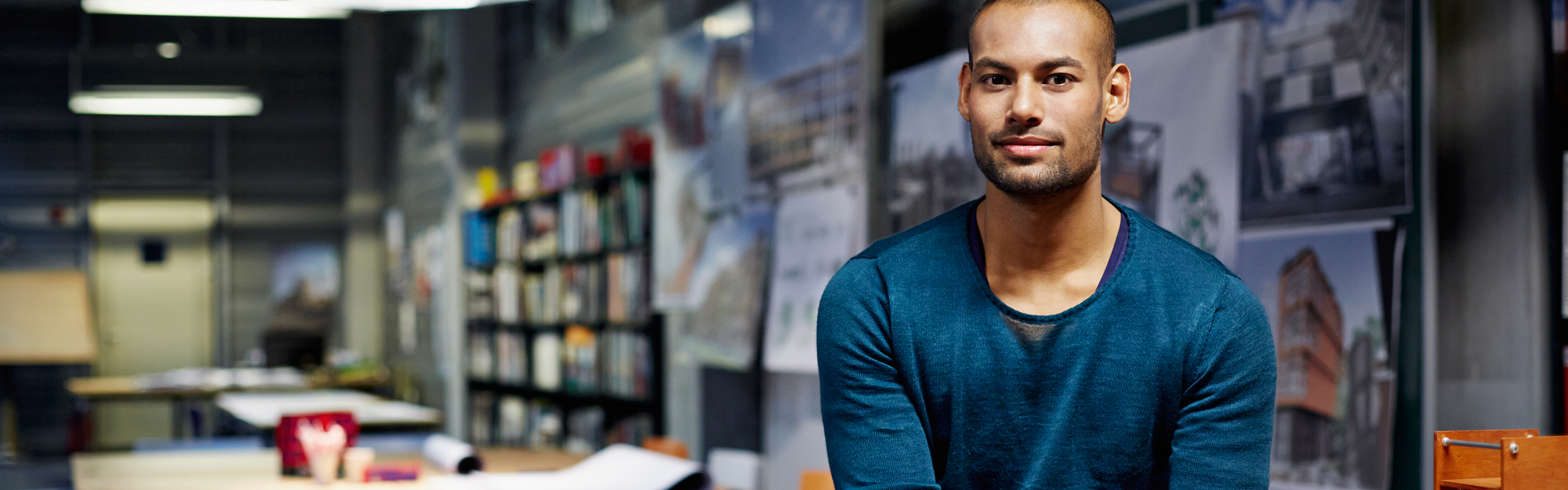 Young man in architect office